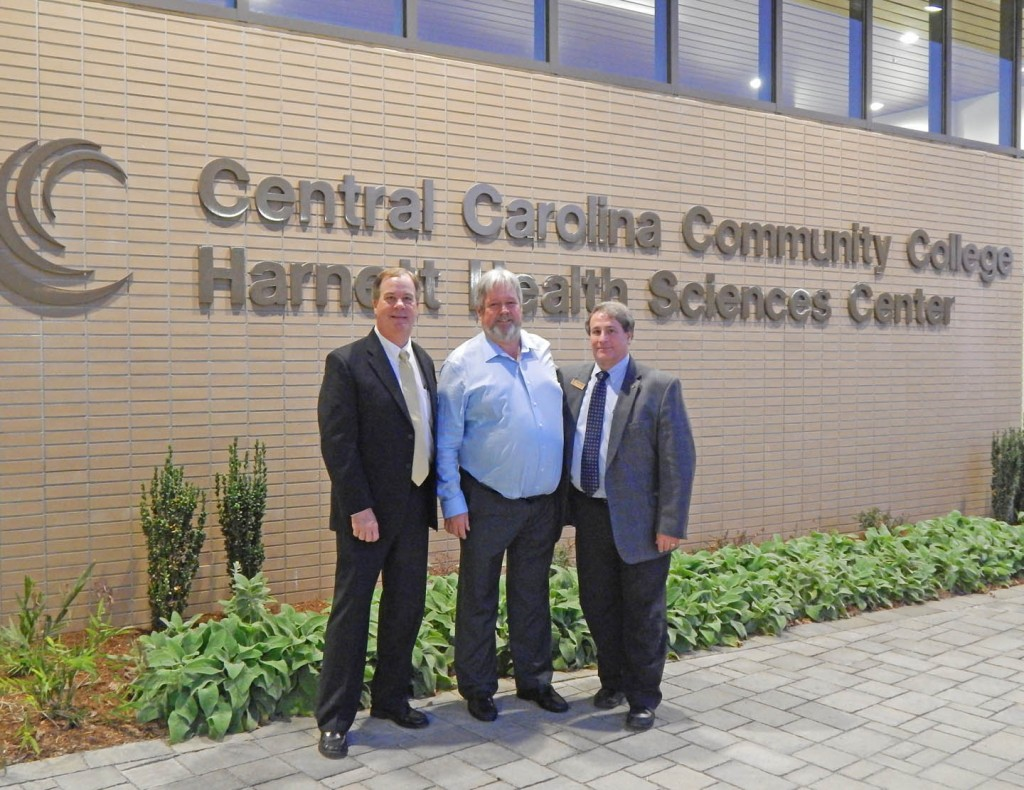 Central Carolina Community College President Bud Marchant (left), former college trustee and former county commissioner Tim McNeill, and CCCC Board of Trustees Chairman Julian Philpott stand outside the college's Harnett Health Sciences Center, in Lillington, following an Oct. 23 presentation by CCCC to McNeill for his service to the college and county.